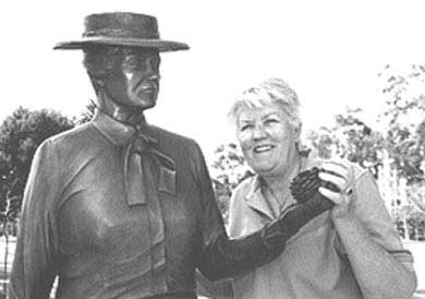 Sculptor Ruth Hayward with her statue of Kate Sessions